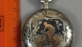 Watch with bicycle motif
