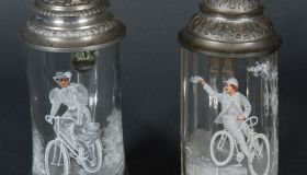 2 decorative glass tankards with bicycle motif